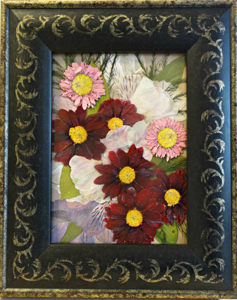 In this small 5x7 frame, an assortment of memorial flowers are showcased as a work of art. This Victorian inspired design is reminiscent of an oil painting and will display a singular flower or an assortment of memorial flowers, as shown here. You have an option to include a custom nameplate, a small prayer card and/or photograph. Finish your custom design by choosing from a large selection of frames and mats. Prices start at $95.