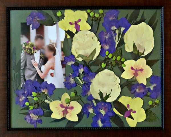 In this 16x20 frame a free formed Victorian inspired design fills the frame and allows you to showcase your wedding flowers as a work of art. With an option to include your groom's boutonniere, a photograph or an invitation. Customize this display with your selection of frame and mat to match your personal style. Prices start at $595