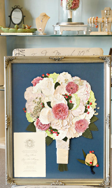 This 16x20 Victorian inspired pressed design allows you to showcase your preserved wedding bouquet as a work of art. There is an option to include your groom's boutonniere, a small photograph and/or a small invitation to add to your design. Customize this display with your selection of frame and mat to match your personal style. Prices start at $595.