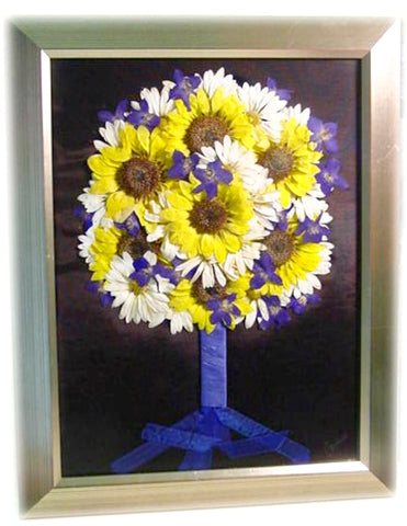 This large 20x24 frame displays a nearly full wedding bouquet. Choose a cascading/free form design or a classic bouquet with wrapped stems. There is plenty of space to accent this custom work of art with a photograph, invitation and/or your groom's boutonniere. Complete you preserved bouquet with a hand selected frame and mat to match your personal style.