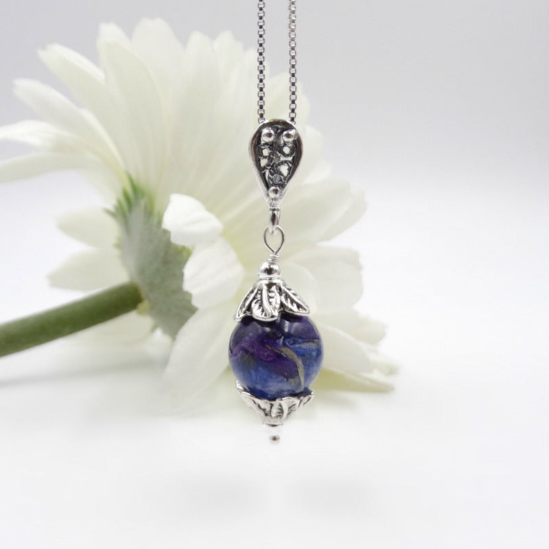 Dried flowers can be added to this pendant from a memorial, birthday, wedding or special event.