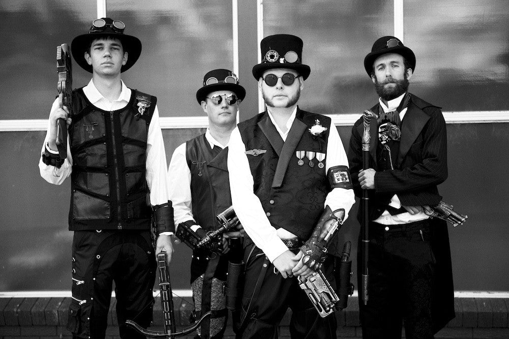 Steampunk Groom and his groomsmen enjoying the wedding