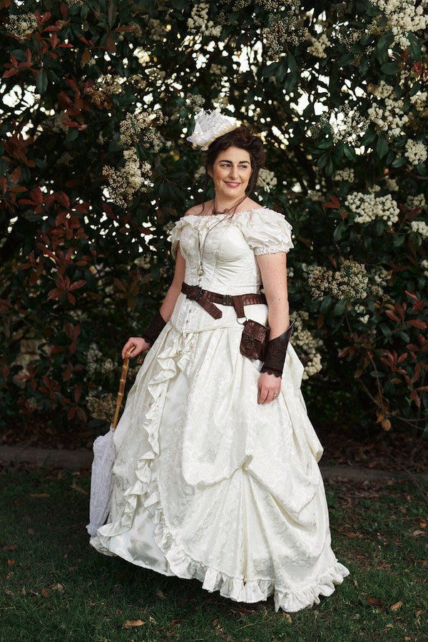 Melissa chose an ivory victorian bridal gown with tight lacing corset