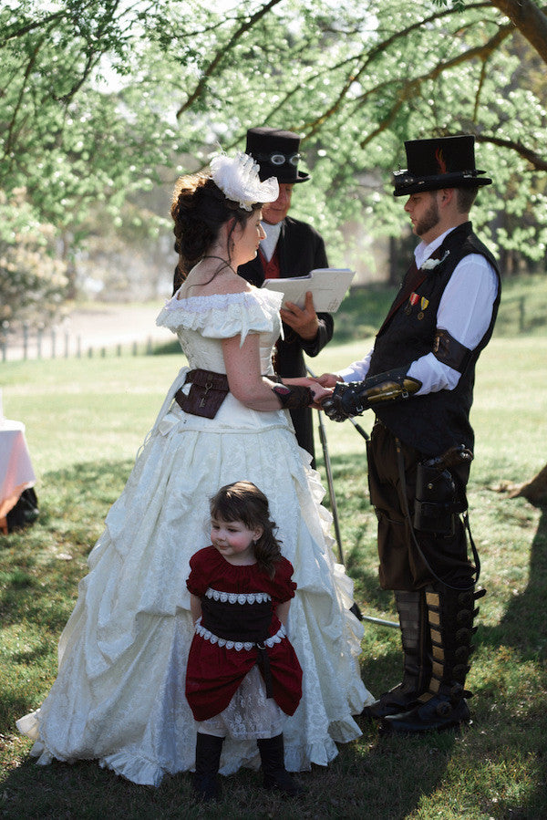 steampunk pastor marrying steampunk couple with child