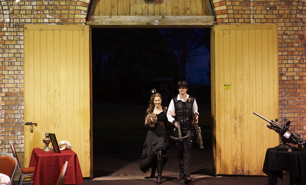 steampunk bridesmaid and groomsman entering steampunk wedding venue