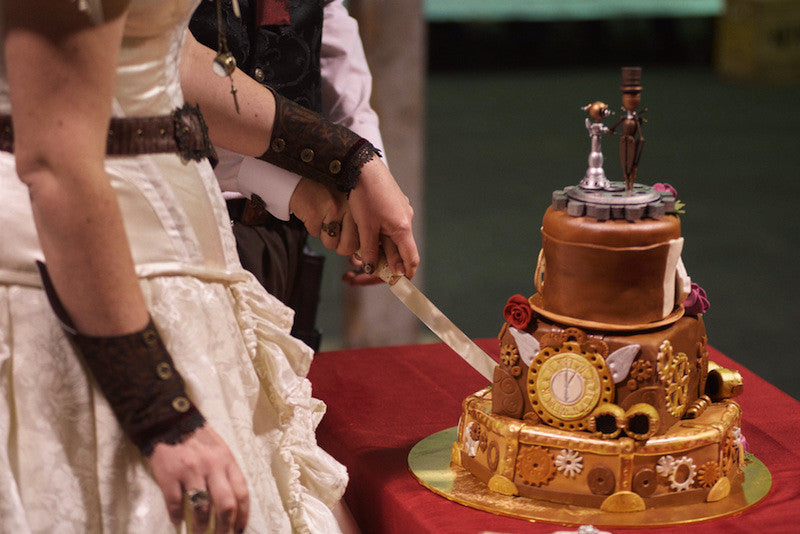 cutting the steampunk cake