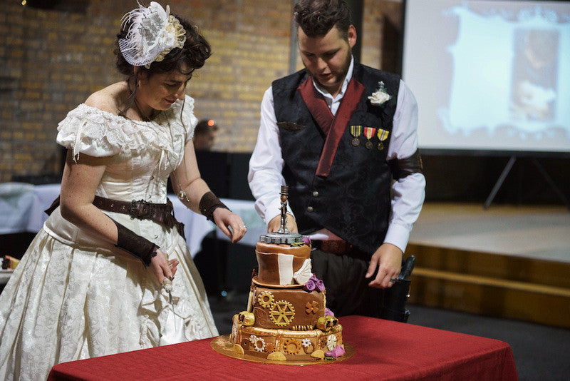 steampunk couple the Nortons with their steampunk wedding cake