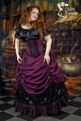 model at Hogwarts library wearing the model showing the matching under bust victorian corset that goes with the Burgundy Beauty skirt set