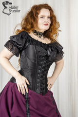 model demonstrating the support given to the bust in the new front lacing version of the Turn of the Century corset