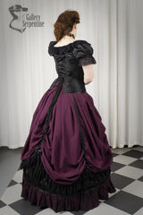 back view of the new front lacing black turn of the century corset worn with a romantic burgundy victorian era skirt set