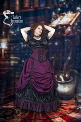 model shows the waist reduction she is getting in the Burgundy Beauty under bust corset