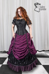 Victorian silhouette on a full figured model showing how to wear the Burgundy Beauty skirt set and the over bust corset with it