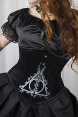 up close view of the black velvet steel boned corset printed with a unique take on the Deathly Hallows from HP fantasy