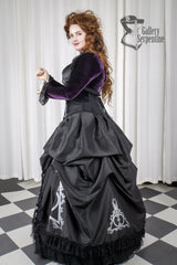 side view of the Black taffeta and black velvet Deathly Hallows Harry Potter fandom gown based on victorian silhouette and tight lacing under bust corset for cosplay and birthdays