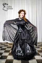 worn with a cathedral print cape like Hogwarts this is the Deathly Hallows Harry Potter fandom gown based on victorian silhouette and tight lacing under bust corset for cosplay and birthdays