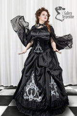 red headed model wearing the full ensemble featuring the Deathly Deathly Hallows victorian skirt set with hoop underpinnings for victorian fantasy cosplay costumes