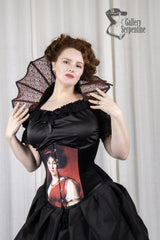 Pre raphaelite artwork on a steel boned under bust corset worn on a red headed model