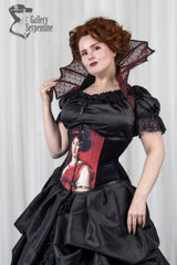 Pre raphaelite artwork on a steel boned under bust corset worn on a red headed model in cosplay costume