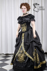 "model has cinched in by 4"" in the Hufflepuff victorian cosplay skirt with hoop underneath in black with gold printing"