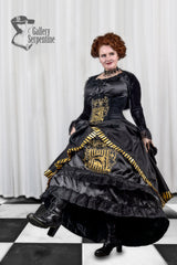 model is dancing in the Hufflepuff victorian cosplay skirt with hoop underneath in black with gold printing