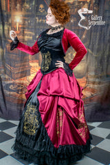 side view of model wearing full Gryffindor cosplay victorian corset gown featuring the Gryffindor Bolero in red stretch velvet
