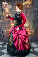 model in the Hogwarts library in full Gryffindor cosplay victorian corset gown featuring the Gryffindor Bolero in red stretch velvet