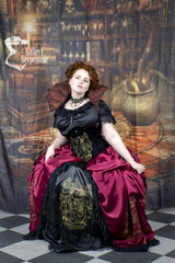 model seated wearing the Gryffindor victorian cosplay corset gown
