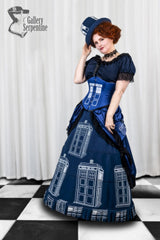 Tardis themed victorian fantasy cosplay gown in blue featuring a steel boned Tardis printed corset on a red headed model