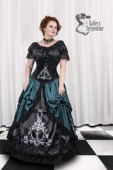 model wearing a Deathly Hallows corset with the matching under skirt and the Sorting Hat indecision victorian HP fandom cosplay skirt in dark green printed with victorian versions of all the House Crests