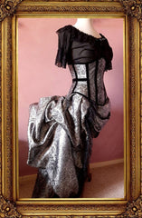 alice in wonderland chemise in black cheesecloth worn with a silver corset and bustle set
