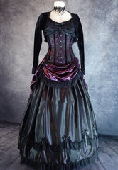 front on full length view of mannequin wearing a gothic victorian corset gown made from amethyst satin, black satin, black gothic lace and worn with a velvet bolero shrug
