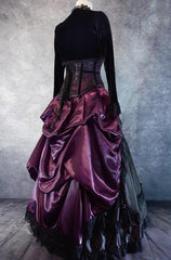 full side back view on a dressmaker's form of the Amethyst Beauty Ball Gown set showing the draping and fullness of the bustle and back of the corset