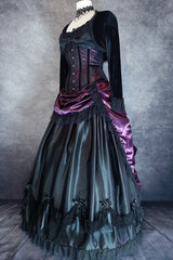 full side front view showing the black Seraphina petticoat in satin overlaying a fully boned hoop skirt with the Amethyst Beauty bustle skirt on top