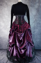 full back view on a dressmaker's form of the Amethyst Beauty Ball Gown set showing the draping and fullness of the bustle and back of the corset