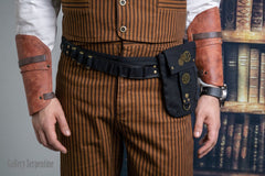 up close on the Tan Outlaw Trousers wearing matching vest and a steampunk belt bag