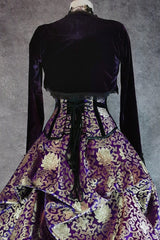 back view of the purple stretch velvet Bolero Shrug worn over a purple & gold corset and victorian skirt