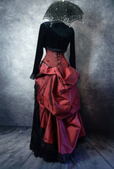 back view of the deluxe length victorian bustle skirt in garnet taffeta worn over a black satin under skirt and bustle cage
