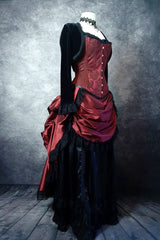 front side view showing the kirtle front drape of the deluxe length victorian bustle skirt in garnet taffeta worn over a black satin under skirt and bustle cage