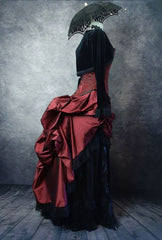 deluxe length victorian bustle skirt in garnet taffeta worn over a black satin under skirt and bustle cage