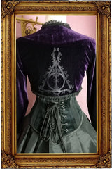 back view of the Deathly Deathly Hallows Bolero Shrug in dark purple stretch velvet with silver Deathly Deathly Hallows print