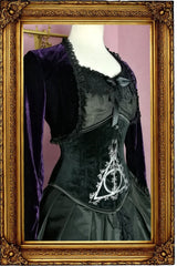 side front view showing the hand screen printed corset in black velvet that is part of the Deathly Deathly Hallows corset gown ensemble