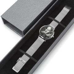 silver version of the Shakespeare watch laid out in a silver and black gift box