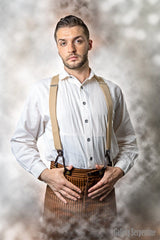 Westworld fantasy image of Westeros model wearing the Gent shirt in natural toned cotton, tan button on braces and high waisted tan outlaw pants