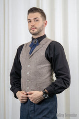 male model wearing the mighty fine herringbone vest is an authentic old wild west 1800s style vest suitable for Sherlock Holmes cosplays or victorian gentleman costumes