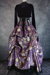 purple and gold brocade bustle skirt and matching corset with purple velvet bolero shown on a mannequin, full length back view showing corset lacing