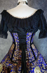 back view of the royal blue and gold steel boned under bust victorian corset showing the corset lacing at the back