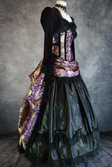 purple and gold brocade bustle skirt and matching corset with purple velvet bolero shown on a mannequin from the side front showing the black satin under layer