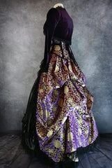 purple and gold brocade bustle skirt and matching corset with purple velvet bolero shown on a mannequin from the side