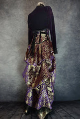 side back view of royal purple gold brocade victorian style bustle skirt with matching under bust corset trimmed in black velvet shown on a mannequin