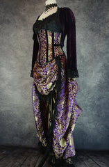 side front view of royal purple gold brocade victorian style bustle skirt with matching under bust corset trimmed in black velvet shown on a mannequin, showing purple velvet Bolero on top